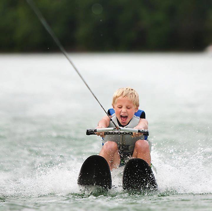 Young boy water skiiing