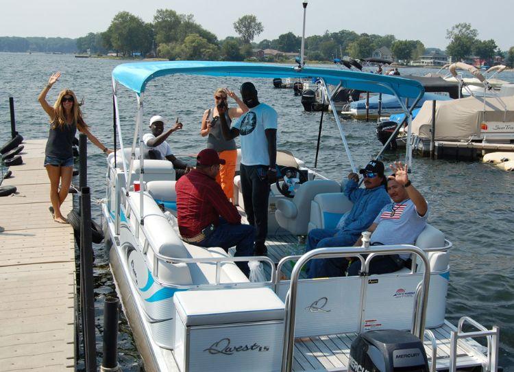 Group renting pontoon boat on Pine Lake