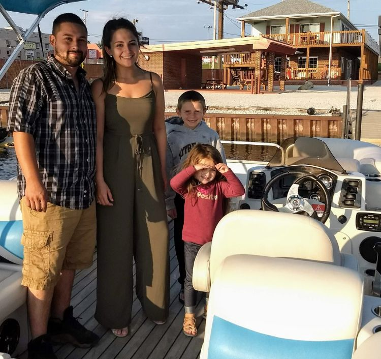 Family renting pontoon for sunset ride