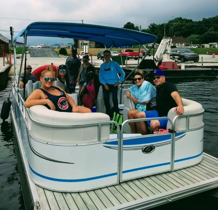 Group taking a cruise on Pine Lake on a pontoon boat