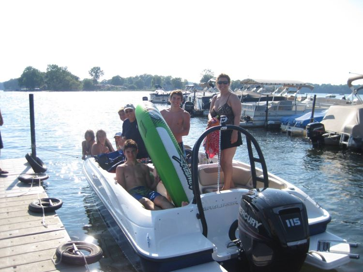 Multiple families renting ski boat with tube
