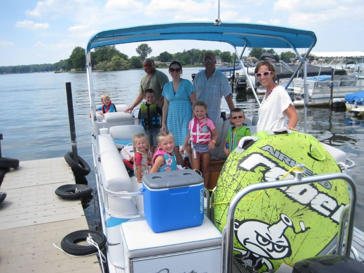Multiple families renting pontoon with tube