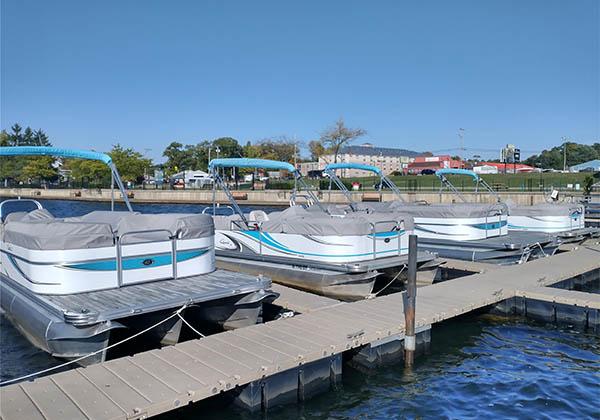 Pontoon boats docked at Pine Lake Marina