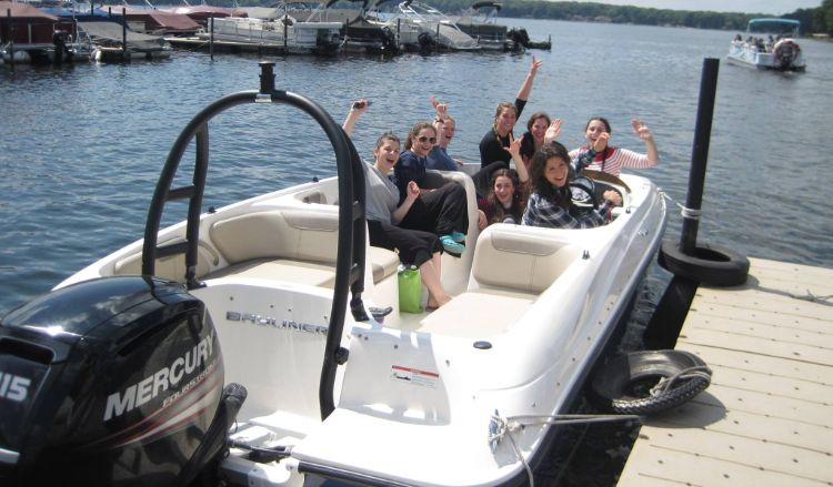 Group of girls taking out the ski boat on Pine Lake