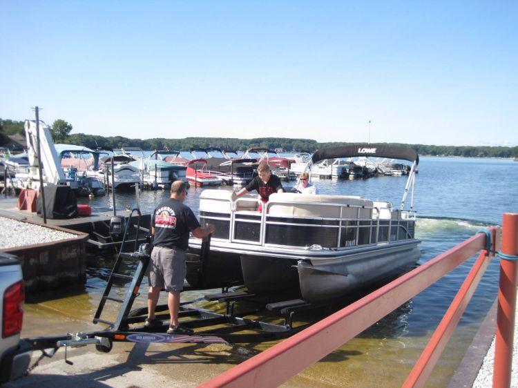 Launching pontoon boat at Pine Lake Marina