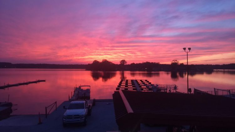 An orange sunset over Pine Lake