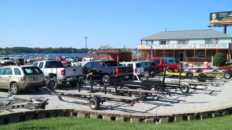 Parking lot full of cars with boat trailers