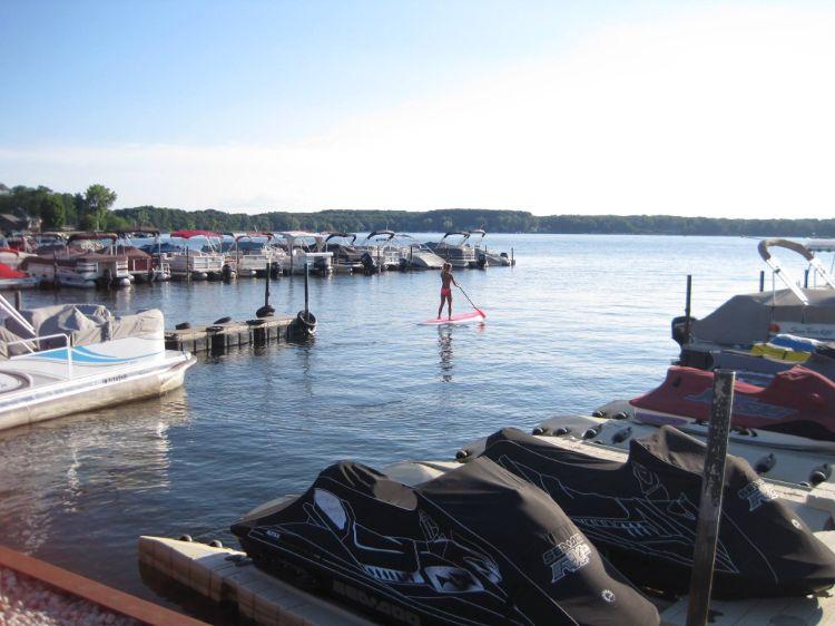 Customer paddleboarding on Pine Lake