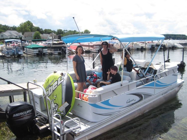 Family renting pontoon with tube