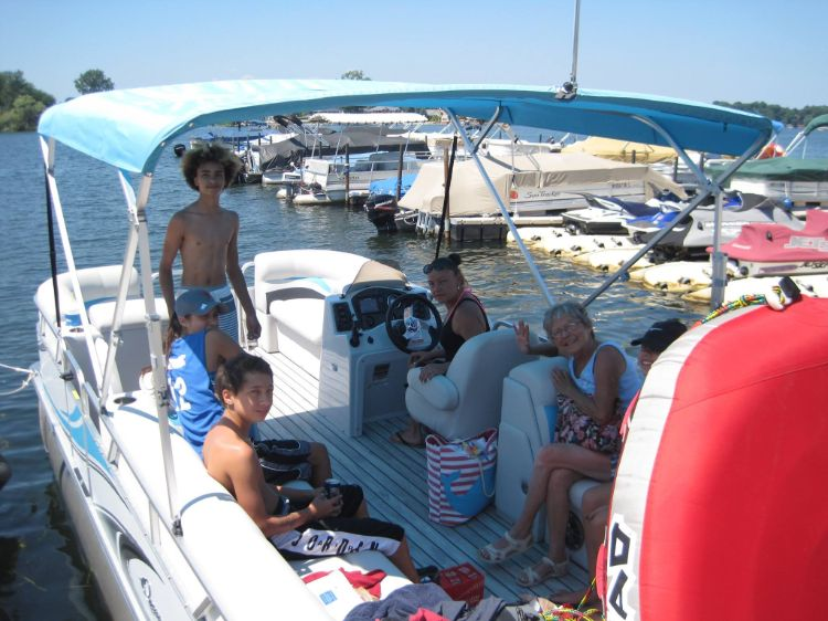 Family taking out pontoon with tube
