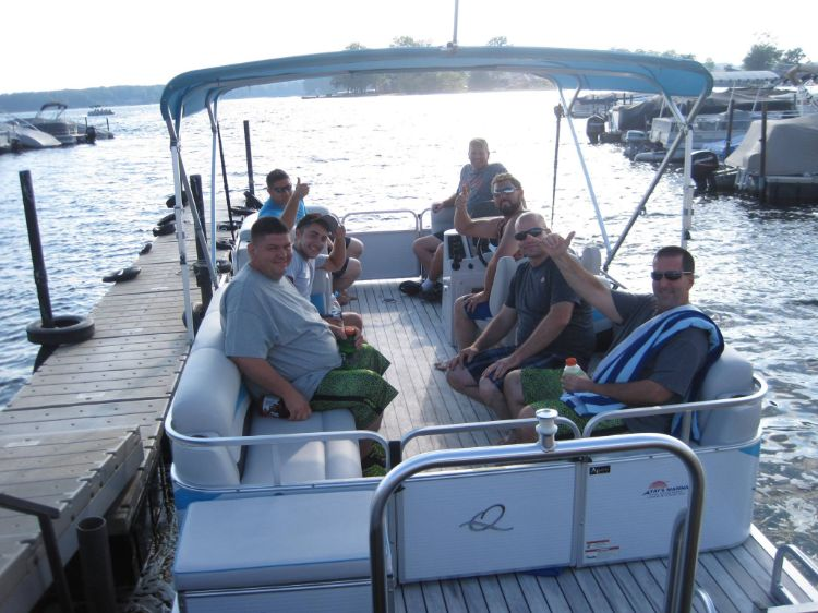 Group of guys taking out pontoon boat for rental