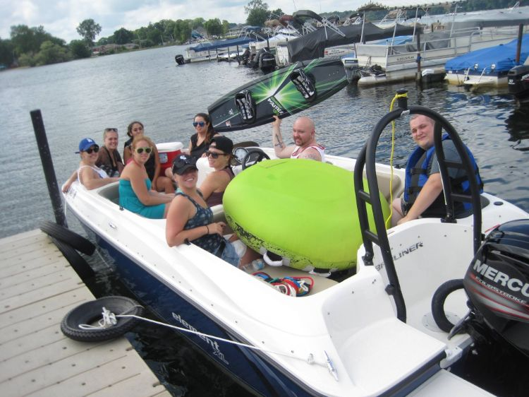 Family taking out ski boat with wakeboard and tube