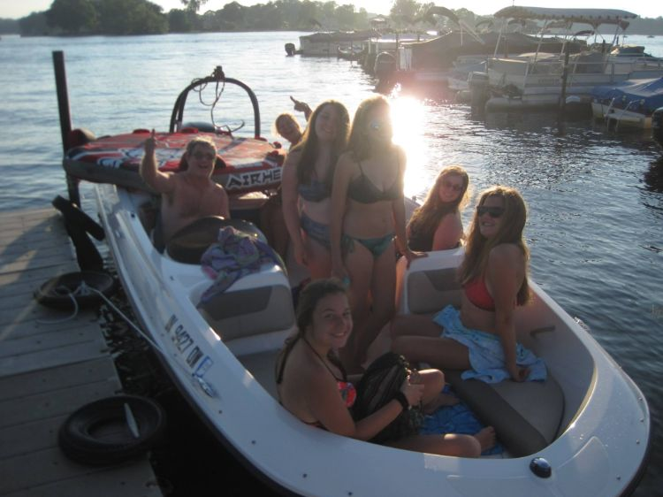 Group of girls taking out ski boat with tube