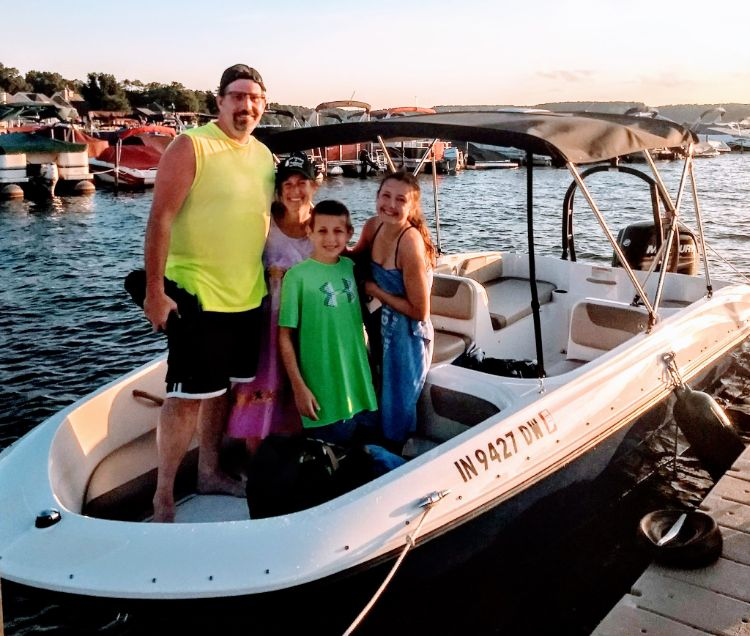Family taking out ski boat