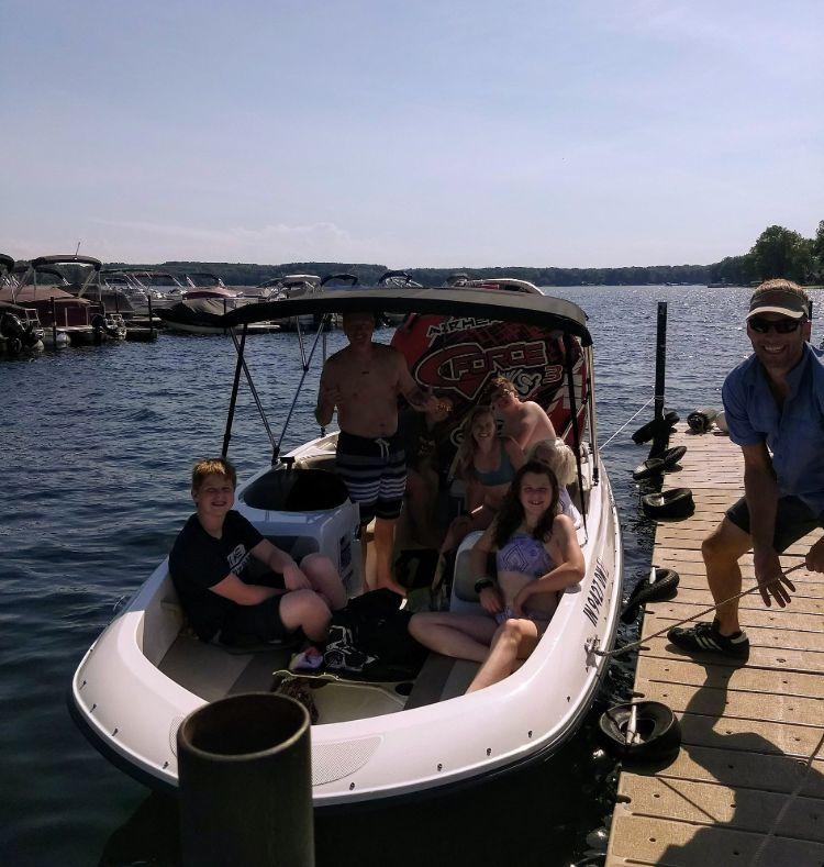 Group departing on loaded ski boat