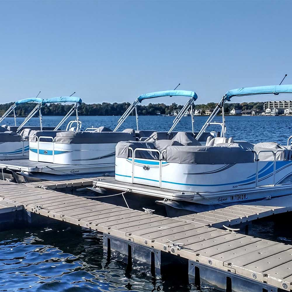 Pontoon boats docked at Pine Lake Marina